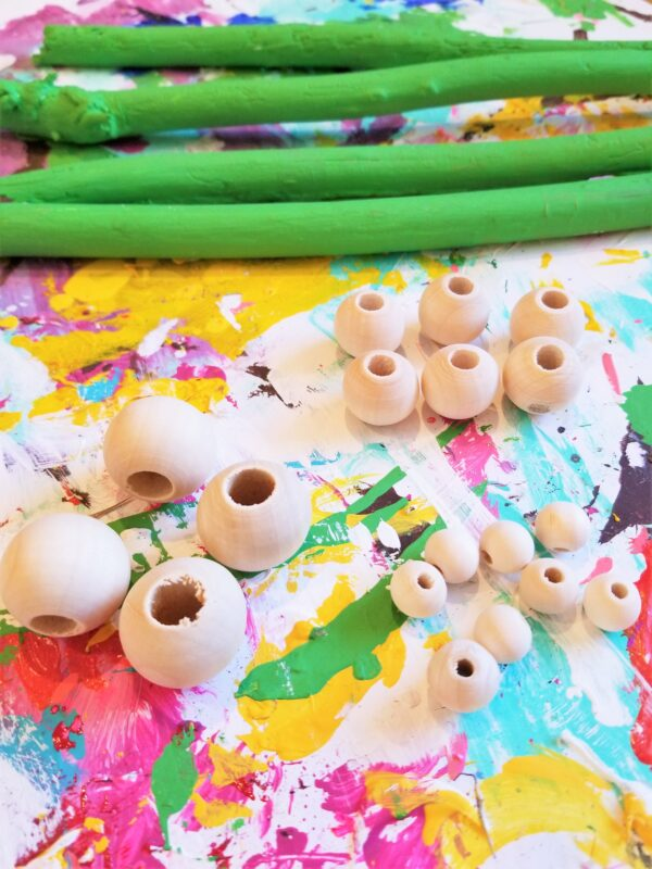 Sticks Green Acrylic Paint Paint Brushes Wooden Beads in varying sizes Hot Glue Hot Glue Gun Tissue paper in your desired color