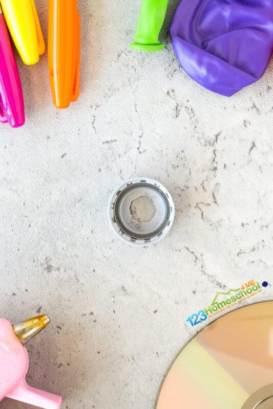make a hole in the cap