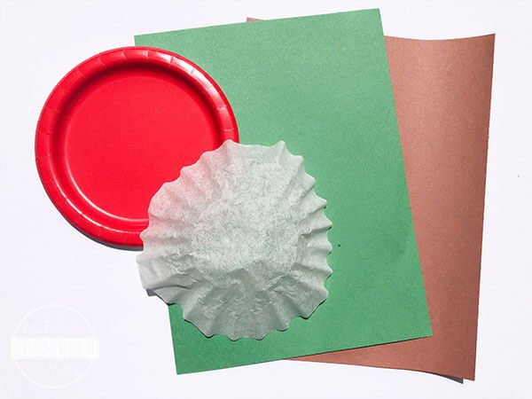 red paper plate, any size coffee filter glue scissors brown paper green paper black marker